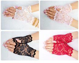 matériaux de porte-clés en gros Promotion Creative dentelle semi doigt gants à l'extérieur femme été conduite anti UV mince dentelle gant de couleur unie de mode