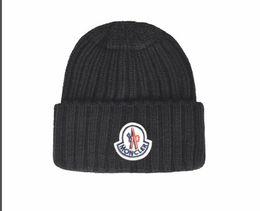 Gorro de lana negro online-2019 new Canada beanie men designer hat casual lana tejida gorra deportiva ski gorro negro azul lana de alta calidad pom pom skull caps