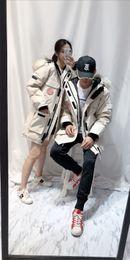 Abrigo de camuflaje impermeable online-Parejas de moda por la chaqueta Canadá 100% pato abajo cubren Hombres Mujeres de mediana edad de invierno Outwear caliente impermeable Espesar Camo Abrigo ganso C110603