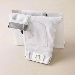 Argentina Nuevo Stryle 19ss Famosos diseñadores de marcas casuales diseñan pantalones vaqueros de moda, pantalones de motocicleta, pantalones delgados, blancos, elegantes, hombres Suministro