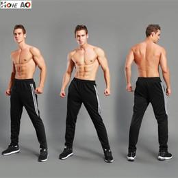 2019 nuevos hombres pantalones de hip hop HOWE AO Pantalones de chándal de Hip Hop de los nuevos hombres Joggers de fitness Primavera Hombre Franja lateral High Street Hip Pantalones largos Pantalones harem Pantalones de chándal nuevos hombres pantalones de hip hop baratos