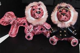 2019 verstellbares kunststoffarmband Lion Rabbit Bär Keychain Designer Handtaschen Geldbörse Rucksack Kette Anhänger Kreative Unisex Tier Hund Taschen Rucksack Schlüsselanhänger Geschenk