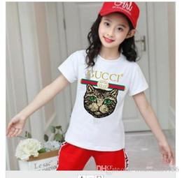 2019 vestido de rayas rojas blancas para niños Diseñador de la marca marca 2-9 años de edad Bebés niños camisetas Camisetas 2019 camisa de verano Tops algodón niños Camisetas niños Ropa 2 colores