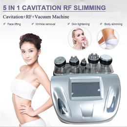 Cavitazione a ultrasuoni a casa online-5 IN 1 La perdita di peso con cavitazione ad ultrasuoni dimagrante ultrasuoni RF vuoto grasso riduce la rimozione della cellulite per uso domestico
