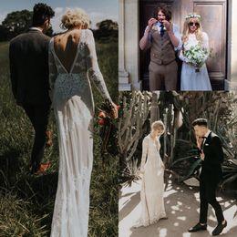 Vestidos de estilo bohemio vintage online-Estilo bohemio vestido de boda de estilo vintage hundiendo línea posterior Vestidos de novia de manga larga Guarnición desnuda Vestido De Noiva