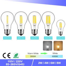 batería led e27 Rebajas A60 Retro Edison Bombilla LED de filamento Regulable E27 COB Bombilla de vidrio 2W / 4W / 6W / 8W Filamento AC220V para lámpara de cristal de araña blanca