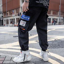 pantalon de sport pour jeunes Promotion Pantalons décontractés pour hommes hip-hop européens et américains, salopettes d'été, pantalons de sport pour jeunes, poche