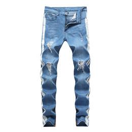 Jeans firmati da uomo KANYE WEST strappato pantaloni lunghi a righe blu chiaro con effetto invecchiato da jeans neri di robin d'oro fornitori