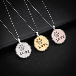 Etiquetas de la pata online-Collar de garra de pata de perro Etiqueta de impresión Collar colgante luminoso Recuerdo de mascotas Joyería de animales Joyería delicada Collar de amor