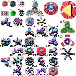 Brinquedos de metal on-line-Nova Fidget spinner brinquedos Tri-Fidget Metal Colorido EDC Gyro Superhero Dragão Rainbow mão spinners dedo brinquedo 120 tipos
