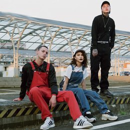 Frauen jeans lätzchen hosen online-Männer High Street Hip Hop-Denim-Overall beiläufige lose Ripped Cowboy Kleidung für 4 Season Male Frauen Paar Harem Bib Jeans-Hosen