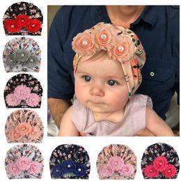 2019 turbantes de criança Chapéus de algodão macio turbante torcido flor pérola gorros chapéu bonés para crianças da criança crianças recém-nascidas bonés meninas bonitos do bebê b13 desconto turbantes de criança