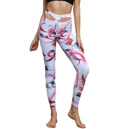 I pantaloni di yoga ballano sexy online-senza giunte delle donne Hip-up igroscopici pantaloni yoga per Athletic Dance Workout Sport Suit stampa Hip Sexy Pants