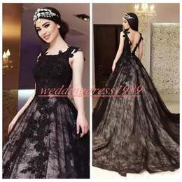 Vestido de encaje negro con forro beige online-Impresionantes perlas góticas negras vestidos de novia apliques de encaje de tul una línea africana robe de mariée tamaño más vestido de novia bola vestidos de novia