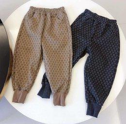 24 monate mädchen jeans Rabatt Heißer Verkaufs-Kind-Baumwollhosen-Jungen-Mädchen-beiläufige Hosen 2 Farben Kindersport-Hosen Haremshosen