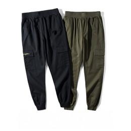 da381b6b07 Diseñador de bolsillo para hombre Pantalones de chándal de cintura elástica Pantalones  deportivos Mujer Carta de moda Impreso 2 colores de cuerpo entero