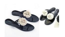 Argentina Envío gratis Tiendas de fábrica Nueva Camelia CHANEL Zapatillas Mujer Flor de cristal Flip-Flop Sandalias Zapatos de gelatina plana Sandalias Suministro