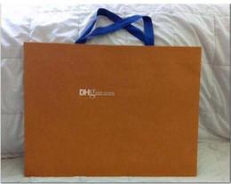 catena di ottone pesante Sconti Tipi di marchio famoso Logo shopping bag di carta Nuovo Packaging Paper Shopping Gift Bag Colore bianco arancio 43cm
