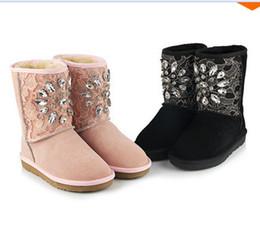 Botte de neige grande taille sexy en Ligne-chaussures pour femmes printemps bottes en caoutchouc pour femmes mi-bas Big EU taille 34-43 2014 mode bottes de neige en cuir strass Sexy dentelle dia