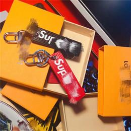 SUP Deri Kutusu ile Basit Stil Araba Anahtarlık Kutusu ile Logo Moda Marka Anahtarlık nereden bebek kız için diy hediye tedarikçiler