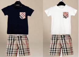 Conjuntos de niños bebés 2 piezas Conjuntos de bolsillo de tela escocesa manga corta boy girl shirt + pantalones cortos a cuadros ropa de niños conjuntos 2 colores envío gratis desde fabricantes