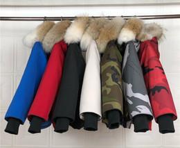 Schwarzer wolfkragen online-kinderjacke designer wintermäntel jungen mädchen kinderparka trendy weiß schwarz kanadischer wolf pelzkragen daunenjacke kinder daunenjacke mit kapuze