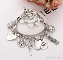Manschettenknopf armband online-Nach Hause Schmuck Armbänder Charm Armbänder Produktdetail Luxus Armband Herren Damen Herz Quaste Schlüssel Charm Anhänger Manschette Armband
