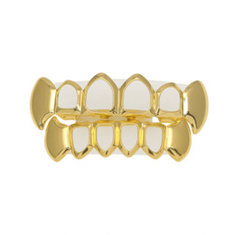 Griglia di denti hiphop online-Hip Hop Hollow Teeth grillz Set For Mens Top & Bottom Faux Dental Tooth Grills women Hiphop Rapper Body Jewelry Gift