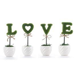 Ceramiche piante artificiali online-La decorazione floreale bianca della siepe di ceramica verde della decorazione di amore ha messo le lettere false della pianta per la decorazione dell'ufficio domestico variopinta