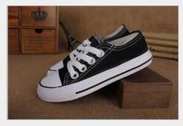 86131dd78a5e5 7 Photos Acheter en ligne Chaussure de toile blanche pour enfants-Nouvelle  marque enfants chaussures de toile