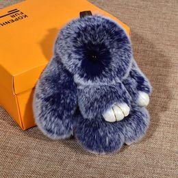 Juguetes heladas online-18 cm estilo Frost Rex Furs conejo juguetes de peluche llavero llavero colgante bolsa encanto del coche etiqueta lindo mini conejo de juguete muñeca de piel real