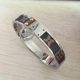 2019 célèbres marques de bracelet homme Nouveau Famous deluxe marque grand 316 L en acier inoxydable 19cm fleur brune bracelets d'amour bracelets hommes Femmes 18k or argent rose bijoux de mariage célèbres marques de bracelet homme pas cher