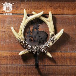 Argentina Europeo y americano ciervo cuerno artesanía gancho creativo baño colgar en la pared de hierro solo ropa gancho de pared gancho electrodomésticos Suministro