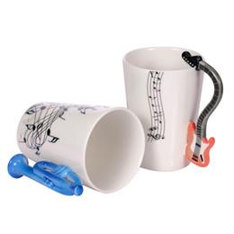 Argentina Venta al por mayor Guitarra Taza de cerámica Personalidad Música Nota Jugo de leche Taza de limón Café Taza de té Oficina en casa Drinkware Regalo único Suministro