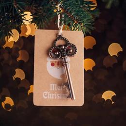 apri di bottiglia di natale Sconti OurWarm 50sets chiave di Santa magico con kraft scheletro di carta apribottiglie allegre decorazioni natalizie per la casa Capodanno ornamento Y18102609
