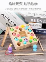 2020 mini bolas magneticas Nuevo clip de madera sólida bola de la pesca magnética dos en uno para niños juguetes de inteligencia de madera pequeños peces de colores Mini pelota rebajas mini bolas magneticas