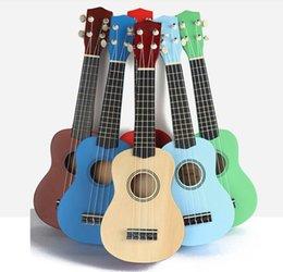 Guitarra havaiana on-line-Best Sellers 21 polegadas ukulele guitarra de brinquedo de quatro cordas elm infantil Hawaiian guitarra acústica quebra-cabeça início educação musical ins frete grátis