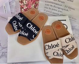 G3017 Envío gratis nuevos productos de verano zapatillas de mujer 2019ss señoras sandalias de la moda modelos salvajes cruz irregular zapatos desde fabricantes