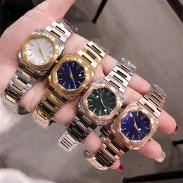 Oros maduros online-High End Ladies White Steel Light Reloj de oro de lujo Moda Metal Pulsera de acero inoxidable Show Women Mature Charm Watch