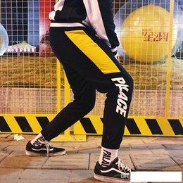 2019 pantalones de jogging amarillo hombres 18AW blanco y negro PALÁC carta de barras logo rojo y amarillo movimiento del pie hombres y mujeres BASCULADORES haz footing pantalones M-XXL pantalones de jogging amarillo hombres baratos
