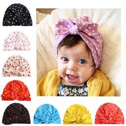 Sombrero de punto para niños online-los niños de diseño sombreros infantiles lunares impresos orejas de conejo tapones de algodón anudada sombrero Pañuelos tapa de turbante accesorios niña pelo de los niños