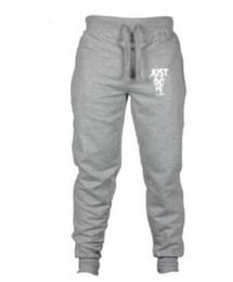 Pantalon spandex en Ligne-Mens Sports Designer Jogger Pants Vêtements Hommes Pantalones Printemps Automne Fitness Pantalon Crayon Pantalon JUSTDOIT