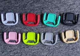 Großhandel eckklammern online-Vier ecke solid color airbag multifunktions teleskop halterung faul autohaken autotelefonhalter großhandel