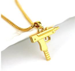 Malas aleaciones online-Joyería de moda para mujer SUP Pistola Collar colgante Bad Girls Aleación Collares Oro / Blanco / negro / Cadena de oro rosa Clavícula