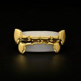 denti griglia d'argento Sconti Gold Grillz Denti Set nuovo di alta qualità Mens Hip Hop Gioielli in oro rosa Argento Fangs Denti Griglie