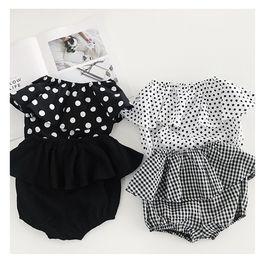 Las muchachas del bebé PP Pantalones cortos Flor de la tela escocesa de lunares impresos de la colmena de los niños pantalones calientes del verano de Corea niños Shorts wt1765 desde fabricantes