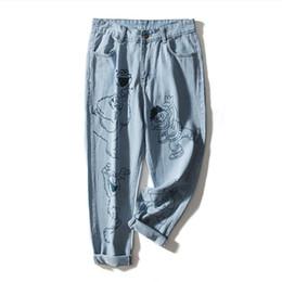 2019 fabrik marke jeans Großhandel fit 90kg plus size Jeans weibliche Art und Weise Marke Cartoon-Muster aus 100% Baumwolle waren dünn Jeanshosen gedruckt wq1773 Fabrik rabatt fabrik marke jeans