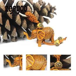 Portapluma de plástico online-Bolso de la vendimia bolso monedero llavero tallado de madera afortunado elefante colgante llavero joyería encantadora clave de plástico decoración cadena titular