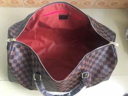 2019 bolsas de lona para mujer 55CM grandes mujeres de los hombres de capacidad famosos bolsas de viaje bolsas de lona clásica diseñador de la venta caliente de los hombres de alta calidad de hombro equipaje de mano