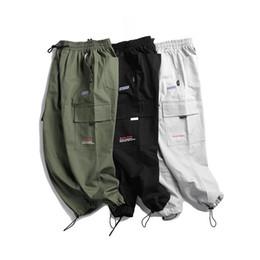 Nuevos hombres Casual Carta Imprimir Pantalones Cremallera Nueve Pantalones Pantalones de moda sólidos simples Pantalones de fiesta de deporte al aire libre 100% algodón desde fabricantes